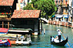 Tourists Gondola On Navigation Channel In Venice